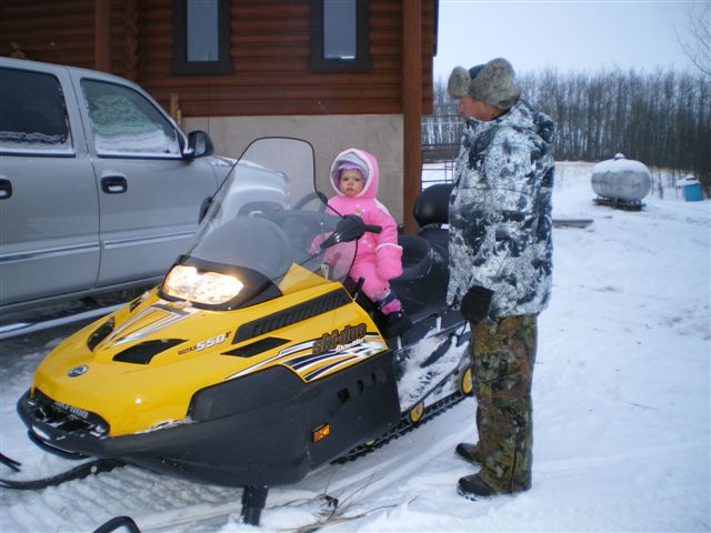 baby on snowmachine